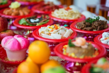 Food plates near the Chinese temple in Singapore, prepared for the believers